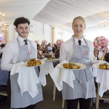 waiting staff serving food