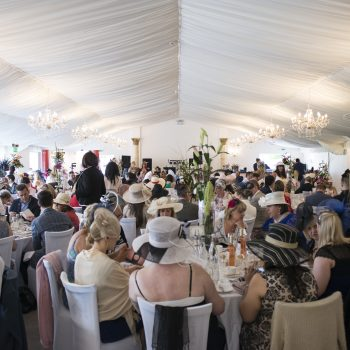 ladies day guests sitting at the tables